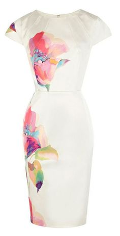white wiggle dress with a bold floral print --- striking and flattering