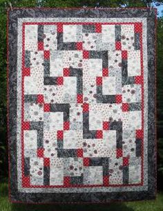 """Double 9's Throw Size Quilt Kit  Large blocks and easy piecing makes this gorgeous black, red, gray and white quilt go together fast! Only 9 blocks make up this 60"""" x 78"""" generous-sized throw. Fabrics are from Henry Glass and Red Rooster. Kit includes all fabric needed for the top and binding as well as the pattern. www.fabric406.com  $60"""