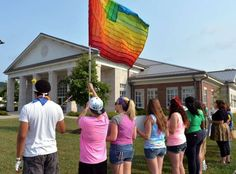 Another false flag. Protesters waive a rainbow flag on the front lawn of the Rowan County Judicial Center, Tuesday, June 30, 2015, in Morehead, Ky. The protest was being held against Rowan County Clerk Kim Davis, who, due to the ruling of the Supreme Court of the United States and her own religious beliefs, has refused to issue any marriage licenses in the county.