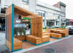 A Parklet in Norfolk, VA. Simple intervention to reclaim car space for pedestrian usage