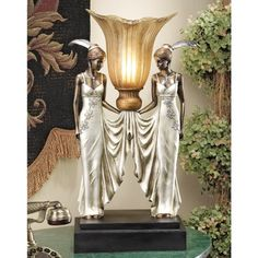 Design Toscano PD331 Art Deco Peacock Maidens Illuminated Statue Design Toscano http://www.amazon.com/dp/B003M0PRP8/ref=cm_sw_r_pi_dp_IHwCub1DVWGBC