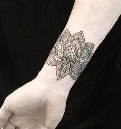 Mandala wrist tattoo by Dominique Holmes