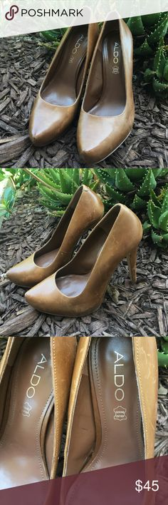 Aldo leather pumps Genuine Leather! Couple scratches ( see picture) About a 5 inch heel. Beautiful brown color. Aldo Shoes Mules & Clogs