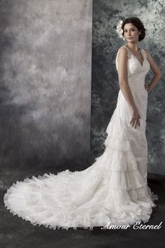 Lace and beaded wedding dress with ruffles| www.amoureternel.co.uk