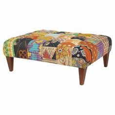 """Crafted from wood and featuring vintage cotton kantha cloth upholstery, this eye-catching cocktail ottoman adds a pop of color to your living room or home library.   Product: OttomanConstruction Material: Vintage cotton kantha and woodColor: Multi Features: Floral-inspired motif Button-tuftedHand-stitched details Dimensions: 18"""" H x 38"""" W x 30"""" DNote: Due to the vintage nature of this product, some wear and tear is to be expected. Products may show signs of brand marks, scrapes, or other ..."""