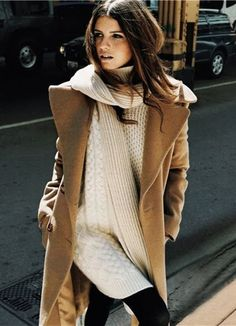 Tan trench coat, thick cream colored long sweater a soft scarf & skinny pants.