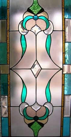 Lovely stained glass - saw so many of these in antique stores in south louisiana. would love to hang one in my kitchen window above my sink.