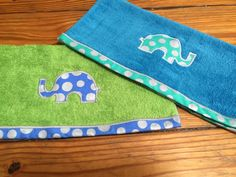 Two very soft microfiber blue and green towels with opposite polkadot elephants embroidered on each. The ends of the towel are also embroidered with the same fabric on each towel.  Great for a burp cloth or a wonderful hand towel.  Very limited quantities so get it while you can!  If you would like a specific color scheme feel free to ask me, I can see what I can make for you