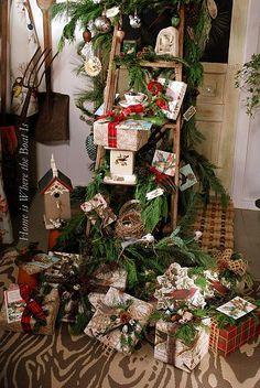Christmas display with ladder  garland.