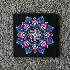 A canvas on a wooden frame of 1.6 cm thick painted with acrylic paint with mandala. The size is 20 x 20 cm. The idea with dots en mandala is inspirited by Elspeth McLean. Shipping the painting within 1-3 days with Track & Trace code. Colors on the pictures can deflect from reality.