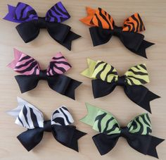 Love zebra print? Then, look no more! Here are six zebra print hair bows: pink, purple, green, yellow, orange and white. Each hair bow has the zebra print ribbon at the top and they are black and the