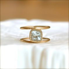 Double Wheel Gold Ring With Aquamarine Stone...would love it in silver