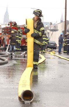 Firefighter after battling a 4-alarm fire in Queens, 2005.