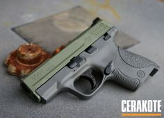 Cerakote Elite Jungle, Concrete and Midnight on this Smith & Wesson M&P Shield pistol. Smith And Wesson Shield, Smith N Wesson, Weapons Guns, Guns And Ammo, M&p Shield 9mm, Tactical Equipment, Military Guns, Self Defense, Firearms