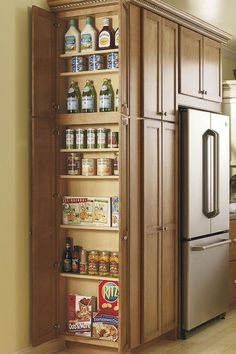 what about adding this w/door to one or both end kitchen cabinets This Utility Cabinet's adjustable shelves make storing all of your pantry items easy and give you the space you need. By Thomasville Cabinetry. Kitchen Redo, Kitchen And Bath, Kitchen Cabinets, Kitchen Ideas, Hidden Kitchen, Pantry Ideas, Pantry Diy, Kitchen Photos, Room Kitchen