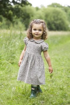 Our Iris dress in Dusky Flowers print, complete with Peter Pan collar and little puff sleeves.