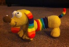 Rainbow Slinky Dog by ShopKimberlie | Crocheting Pattern - Looking for your next project? You're going to love Rainbow Slinky Dog by designer ShopKimberlie. - via @Craftsy