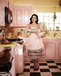 Dita - in her happy pink kitchen - with Eva looking on...Eva is missing if you are in the Los Angeles please keep an eye out.