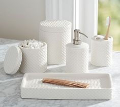 Finished in white, these textural storage pieces are a dressy update to the bath.