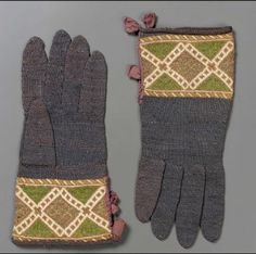 Pair of gloves        probably Spanish, 17th century         Spain  Dimensions  Medium or Technique      Silk knit    Accession Number      38.1264a-b