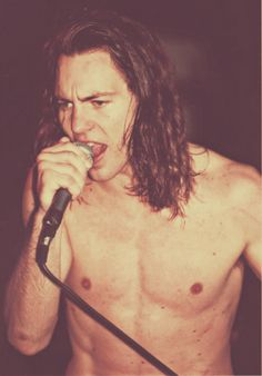 Eddie Vedder. he was so handsome when he was young. <--- true. But I think he looks even better now.
