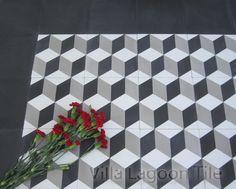 Cubes encaustic cement tile, with a black border. Villa Lagoon Tile