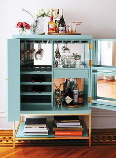 The Furniture Piece You're Missing for the Holiday Season: The Bar Cabinet–Lacquered Bar Cabinet in Mint: $1,998, Anthropologie.