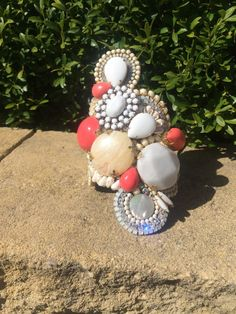This gorgeous statement cuff has been created using multiple stones, rhinestones and beads in cream and white with large white and coral feature stones #statementwristcuff #statementwristwear #whitebangle #coralbangle