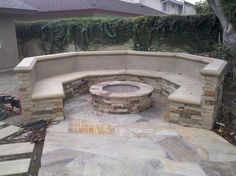 Outdoor Fire Pit with Natural Stone siding and Flagstone Deck. | Yelp