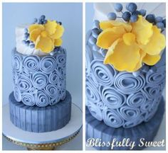 Blue rolled flowers with yellow flower accent cake