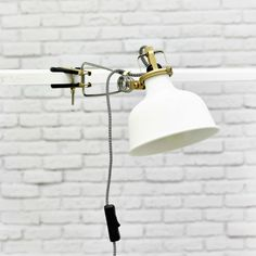 IKEA Fan Favorite: RANARP clamp spotlight. This stylish spotlight with adjustable head will add an industrial touch to any room.