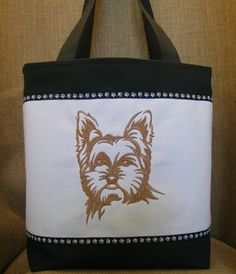 This handmade tote features an embroidered Yorkshire Terrier.  It makes a great gift for any yorkie lover.
