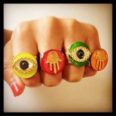 Boom  make an impact with #danalevy neon enamel hamsa charm & evil eye rings