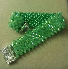 Pattern from Off the Beaded Path on You Tube - Bring on the Bling. Fun pattern with seed beads and crystals. Used Chinese crystals. The tute for this is here: http://www.fusionbeads.com/Embellishing-Netting ~ Seed Bead Tutorials