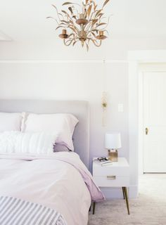 The bed is Anthropologie and the bedding Matteo Home. The side table is from West Elm.