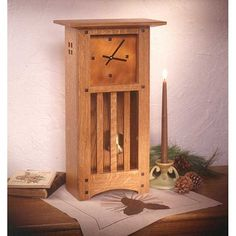 """Arts and Crafts Mantle Clock - Downloadable Plan $5.95. It's hard to beat the elegant good looks of handcrafted mission-style pieces. We've continued that tradition with this handsome 21"""" tall tabletop clock. Quartersawn oak, tapered square buttons, and an """"aged"""" copper face make for a timepiece guaranteed to garner compliments. Small Woodworking Projects, Woodworking Patterns, Popular Woodworking, Woodworking Furniture, Fine Woodworking, Furniture Plans, Woodworking Crafts, Wood Projects, Woodworking Classes"""