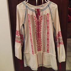 Free people embroidered tunic Rare FP tunic. Worn a couple times, in perfect condition. Tag says size 2. Fit is loose, could fit an xs or small. This is a unique piece that doesn't come up for sale often! Free People Tops Tunics