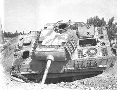 """The same vehicle a month later photographed by the Polish 2nd Corps photographer. Between the radio and driver compartments is the stenciled inscription, it reads: """"taken by the 6 Gurkha Rifles 14/20 Hussars"""". Also of note is the extra armor plates on the turret roof."""