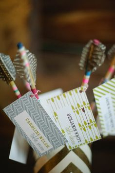 feather escort cards // photo by Christina Lilly Quality archerytag equipment at https://www.etsy.com/shop/ArcherySky