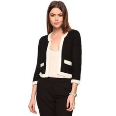 """Cream Ivory Trim Open Cardigan Sweater Jacket S A classy textured knit cardigan that features contrast trimming and a split round neckline. Open front. Decorative front pockets. 3/4 sleeves. Medium in weight.  DETAILS:  - 17"""" approx. length from high point shoulder to hem, 34"""" chest, 30"""" waist, 18"""" sleeve length from shoulder ridge, 13"""" shoulder width -53% acrylic, 47% cotton  Model Info: Height: 5'10"""" 