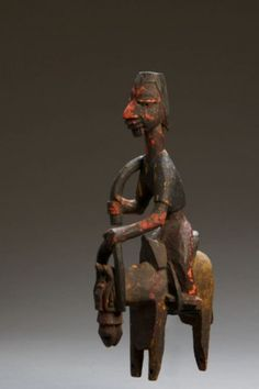 Equestrian Figure in the form of a Colonial Officer Yoruba peoples, Nigeria 20th Century Wood, pigments 12.25 x 3 x 6 inches