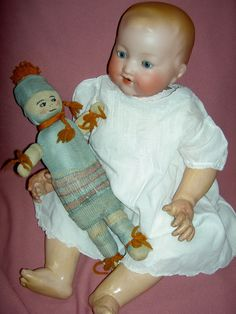 """Jointed, antique celluloid, baby doll (boy or girl) measuring just about11"""" long with beautifully molded and painted features including light blond hair, blue eyes and open/closed mouth with molded tongue, jointed at the shoulders and hips with bent, baby-style chubby limbs with finely detailed fingers and toes.   eBay!"""