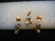 $245.00 | A lovely set of Pearl and Diamond earrings with the matching Pendant in 18K Yellow Gold