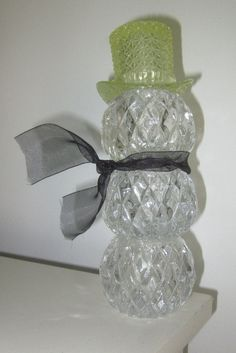 one of a kind! Up cycled Art  Welcome! Offering this fancy crystal snowman with yellow Vaseline Top Hat with black scarf measuring 8.5 high