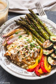 Roasted Vegetables and Couscous Bowl with Moroccan Spiced Chicken. A healthy and delicious meal a whole family will love!