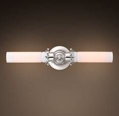 Edison Milk Glass Sconce Inline Double Polished Nickel.  Wall lighting.  Bathroom.  http://www.restorationhardware.com