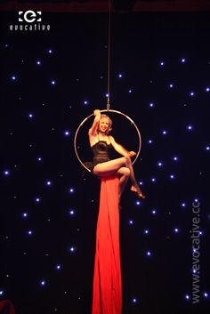 Burlesque girl performs in a hanging ring with an LED starfield background. #EventPhotography