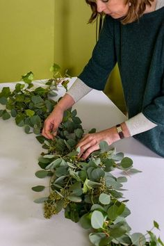 How to make this year's biggest wedding decoration trend: greenery table garland.