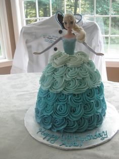 Another view of the Elsa cake with teal ombré rose effect skirt. #frozen cakes #elsacakes www.anniesjustdesserts.com