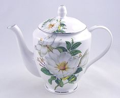"""I just love the shape of this elegant teapot... so well balanced, it is a dream to pour from. And the bone china is so light and delicate. This beauty features a stunning Magnolia Chintz design perfectly set against the white fine bone china background. The large lid covers a wide opening, perfect for ease of excellent tea making. Generously sized, she stands 7.5"""" tall and measures 9"""" across inclusive of handle and spout. Comes nestled in matching box."""